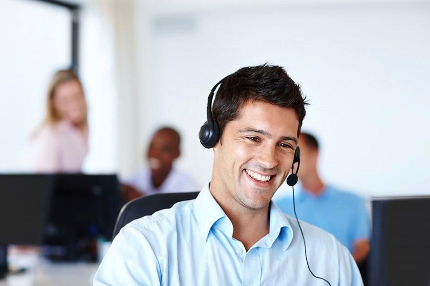 an employee talks with headphone