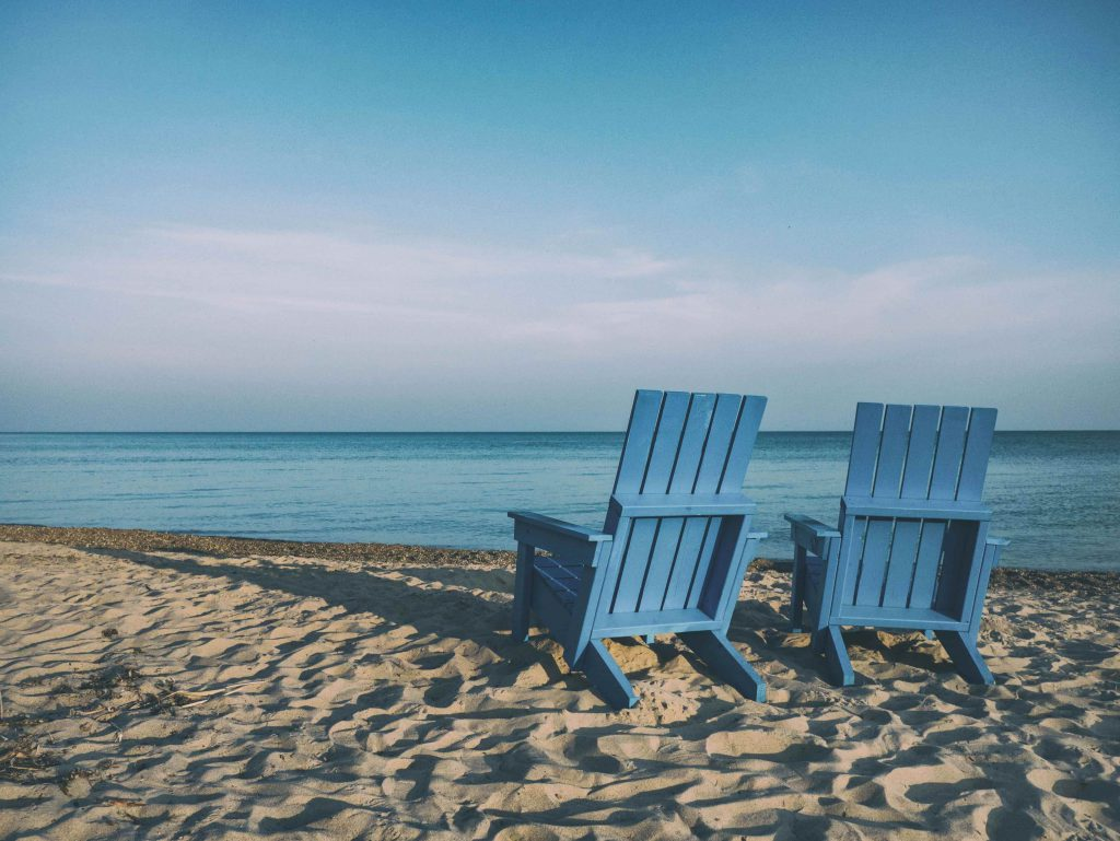 two chairs in beach with blue color
