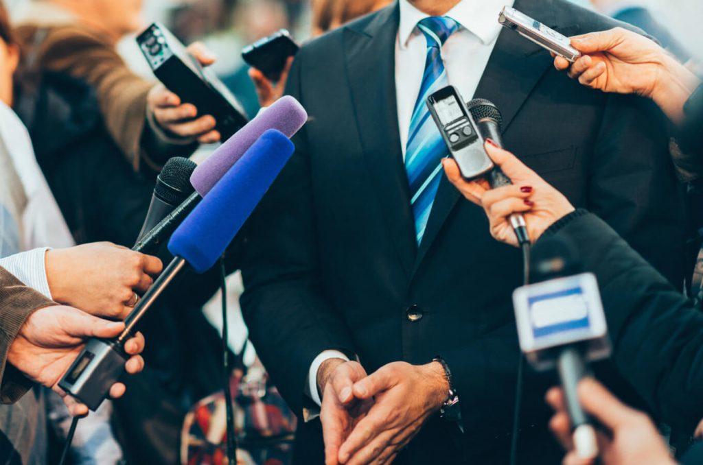 a PR talks to media