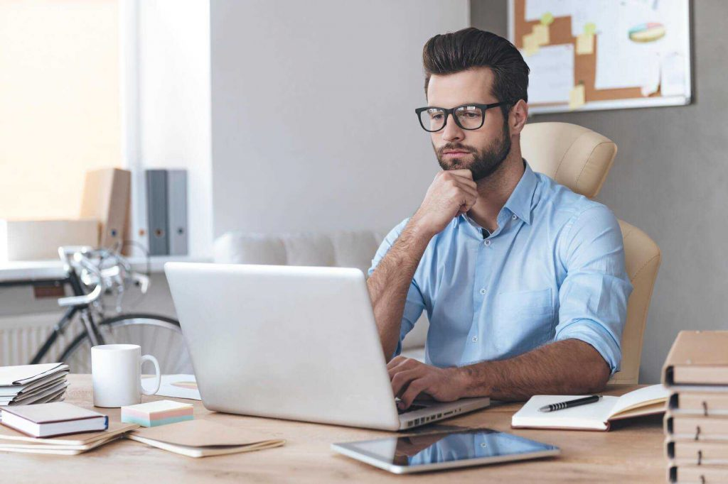 social media manager working with laptop